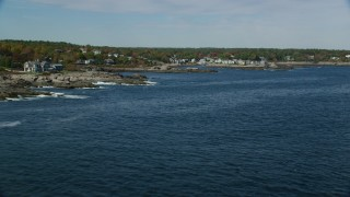 AX147_249 - 6k stock footage aerial video flying low over water, approaching oceanfront homes, autumn, Ogunquit, Maine