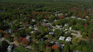AX147_252 - 6k stock footage aerial video flying by residential neighborhood, pan right, reveal coast, autumn, Ogunquit, Maine