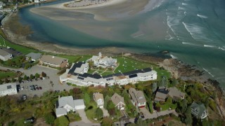 AX147_253 - 6k stock footage aerial video flying over Beachmere Inn, sand bars at low tide, Ogunquit, Maine