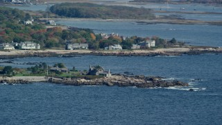 AX147_255 - 6k stock footage aerial video flying by Bush Compound, rocky coast, autumn, Kennebunkport, Maine