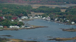 AX147_259 - 6k stock footage aerial video flying by waterfront homes, small cove, autumn, Kennebunkport, Maine