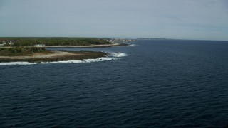 AX147_263 - 6k stock footage aerial video flying by the coastline, approaching coastal town, Biddeford, Maine