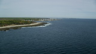 AX147_264 - 6k stock footage aerial video flying by coastline, approaching oceanfront homes, autumn, Biddeford, Maine