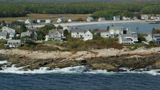 AX147_265 - 6k stock footage aerial video flying by oceanfront homes, autumn, Biddeford, Maine