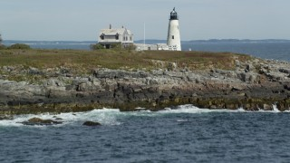 AX147_270 - 6k stock footage aerial video revealing and approaching Wood Island Light, autumn, Biddeford, Maine