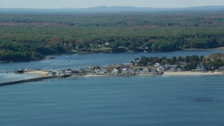 AX147_273 - 6k stock footage aerial video approaching oceanfront homes, Saco River, autumn, Saco, Maine