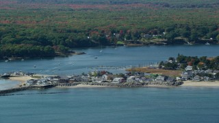 AX147_274 - 6k stock footage aerial video flying by oceanfront hones, Saco River, autumn, Saco, Maine