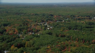 AX147_277 - 6k stock footage aerial video flying over rural homes, autumn trees, tilt down, Biddeford, Maine