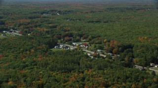 AX147_278 - 6k stock footage aerial video flying by rural homes off of Guinea Road, autumn trees, Biddeford, Maine