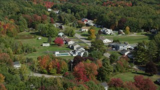 AX147_291 - 6k stock footage aerial video flying by rural homes, Guinea Road, autumn, Biddeford, Maine