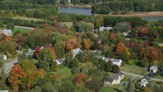 AX147_292 - 6k stock footage aerial video flying by rural homes, Guinea Road, Meeting House, Road, autumn, Biddeford, Maine