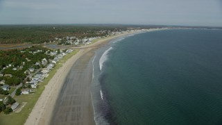 AX147_294 - 6k stock footage aerial video flying by a beach and coastal town, autumn, Old Orchard Beach, Maine