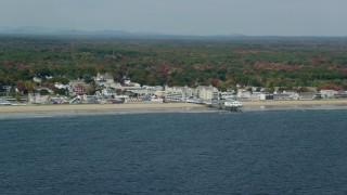 AX147_296 - 6k stock footage aerial video flying by beach, pier and Palace Playland, autumn, Old Orchard Beach, Maine