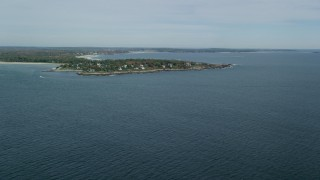 AX147_298 - 6k stock footage aerial video approaching a coastal town in autumn, Scarborough, Maine