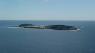 AX147_300 - 6k stock footage aerial video flying by Richmond Island, Cape Elizabeth, Maine