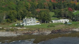 AX147_301 - 6k stock footage aerial video flying by oceanfront mansions, colorful autumn trees, Cape Elizabeth, Maine
