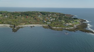 AX147_302 - 6k stock footage aerial video approaching upscale oceanfront homes, autumn, Cape Elizabeth, Maine