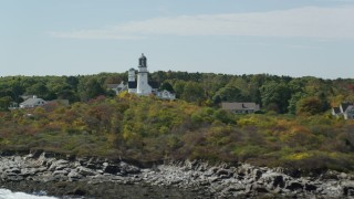 AX147_306 - 6k stock footage aerial video flying away from coastal town, Cape Elizabeth Light, autumn, Cape Elizabeth, Maine
