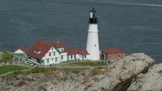 AX147_315 - 6k stock footage aerial video orbiting Portland Head Light, autumn, Cape Elizabeth, Maine