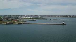 AX147_319 - 6k stock footage aerial video flying by Spring Point Ledge Light, coastal city, autumn, Portland, Maine