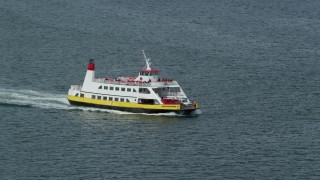AX147_320 - 6k stock footage aerial video tracking a ferry carrying passengers and vehicles, Portland, Maine