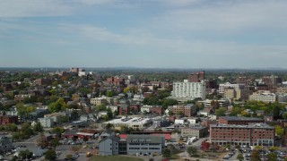 AX147_324 - 6k stock footage aerial video flying by apartments, office buildings, autumn trees, Portland, Maine