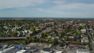 AX147_325 - 6k stock footage aerial video orbiting apartments, Saint Dominics Roman Catholic Church, autumn, Portland, Maine
