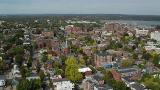 AX147_326 - 6k stock footage aerial video orbiting apartments, Saint Dominics Roman Catholic Church, autumn, Portland, Maine