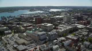 AX147_331 - 6k stock footage aerial video orbiting Portland City Hall, downtown, autumn, Portland, Maine