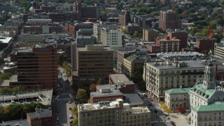 AX147_332 - 6k stock footage aerial video orbiting downtown office buildings, autumn, Portland, Maine