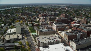 AX147_334 - 6k stock footage aerial video flying over downtown office buildings, autumn, Portland, Maine