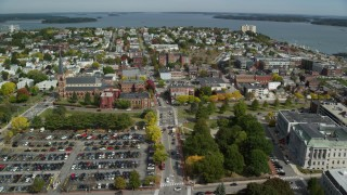 AX147_339 - 6k stock footage aerial video flying over downtown, approaching coastal town, autumn, Portland, Maine