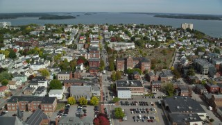 AX147_340 - 6k stock footage aerial video flying over a neighborhood approaching a coastal town, Portland, Maine