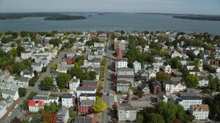 AX147_341 - 6k stock footage aerial video flying over Congress Street to Portland Observatory, coastal town, Portland, Maine