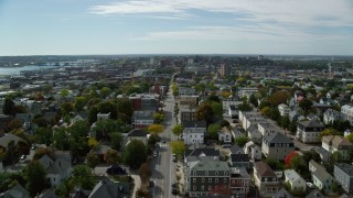 AX147_348 - 6k stock footage aerial video flying over Congress Street, approach Portland Observatory, neighborhood, Portland, Maine