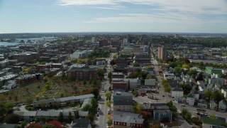 AX147_349 - 6k stock footage aerial video flying over Congress Street, approach Portland City Hall and a cathedral, Portland, Maine
