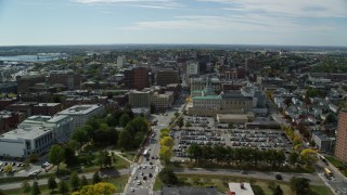 AX147_350 - 6k stock footage aerial video flying over Congress Street, approach Portland City Hall, Portland, Maine