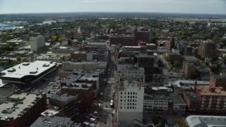 AX147_351 - 6k stock footage aerial video flying over Congress Street, approaching hotel and tv station, autumn, Portland, Maine