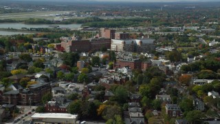AX147_352 - 6k stock footage aerial video approaching Maine Medical Center, autumn, Portland, Maine