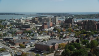 AX147_358 - 6k stock footage aerial video flying by downtown, office buildings, autumn, Portland, Maine