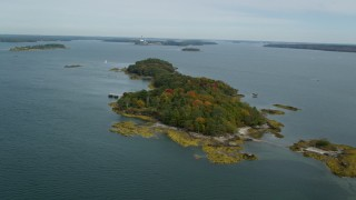 AX147_367 - 6k stock footage aerial video flying by Clapboard Island with colorful autumn trees, Falmouth, Maine