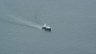 AX147_372 - 6k stock footage aerial video tracking a fishing boat on the water, Chebeague Island, Maine