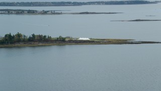 AX147_373 - 6k stock footage aerial video flying by a pavilion on an island, autumn, cloudy, Harpswell, Maine