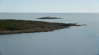 AX147_376 - 6k stock footage aerial video flying by lighthouse on Little Mark Island, autumn, Harpswell, Maine