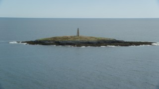 AX147_377 - 6k stock footage aerial video flying by a lighthouse on Little Mark Island, Atlantic Ocean, Harpswell, Maine