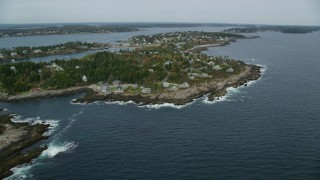 AX147_379 - 6k stock footage aerial video flying by coastal town, Bailey Island, autumn, Harpswell, Maine