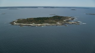 AX147_380 - 6k stock footage aerial video approaching an isolated house, Ragged Island, autumn, Harpswell, Maine
