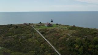 AX147_390 - 6k stock footage aerial video orbiting Seguin Light, Seguin Island, autumn, Phippsburg, Maine