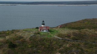 AX147_394 - 6k stock footage aerial video orbiting Seguin Light on Seguin Island, autumn, Phippsburg, Maine