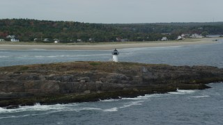 AX147_395 - 6k stock footage aerial video approaching Pond Island Light, Pond Island, autumn, Phippsburg, Maine